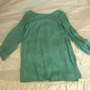 Long sleeve/open back shift dress